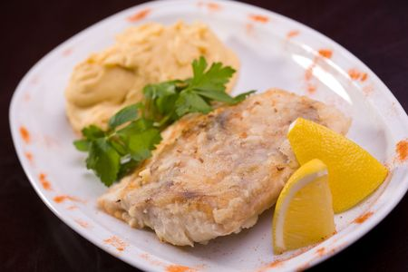 Fried fish and hummus with lemon, selective focus  photo