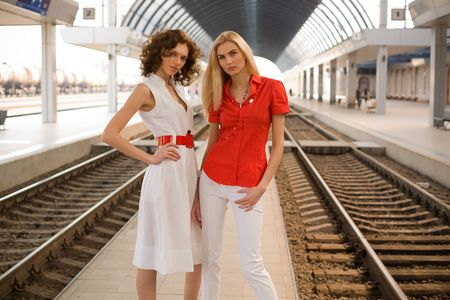 Beautiful girls outdoors on railway station  photo