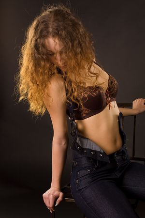 Attractive red-haired girl, studio shot  photo