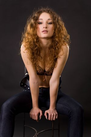 Portrait of beautiful red-haired girl, studio shot  photo