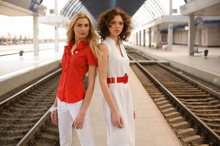 Two pin-up girls on railway station  photo