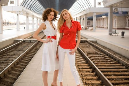Pin-up girls on railway station  photo