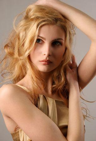 Nice young blond girl, closeup studio shot Stock Photo