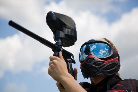 Closeup paintball player, summer outdoor shot
