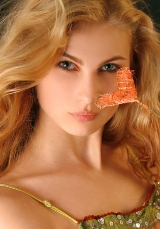Attractive long-haired blond girl, closeup studio shot Stock Photo - 5135708
