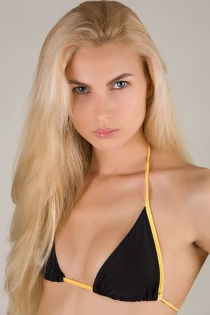 Nice girl in bra isolated in studio, closeup shot photo