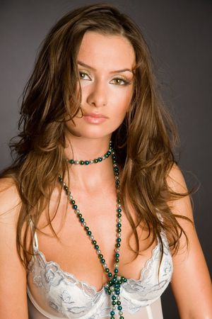 Portrait of brunette attractive girl isolated on black, studio shot photo