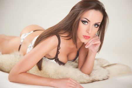 Girl with green eyes laying on fur, close up shot Stock Photo - 6518846