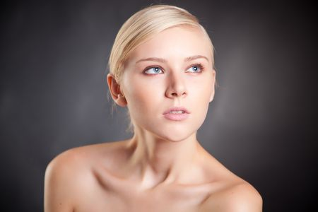 Portrait of young blond looking up girl, close up shot photo