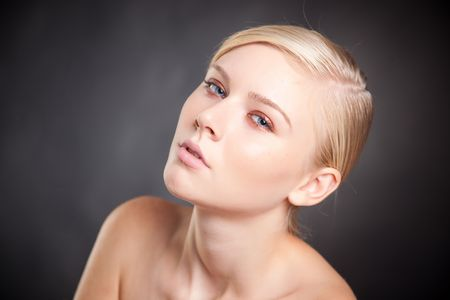 Portrait of attractive blond girl, close up shot photo