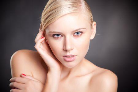 Girl with blue eyes, close up studio isolated shot photo