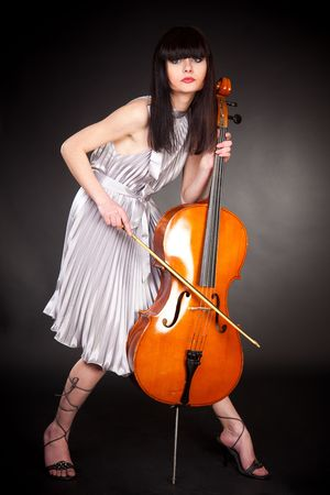 Brunette girl with cello, close up studio isolated shot photo
