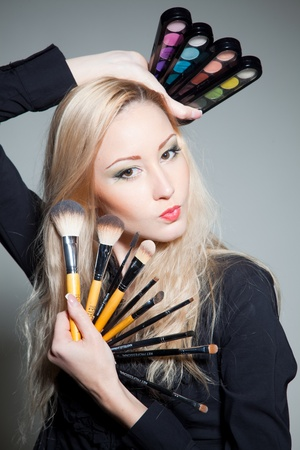 Nice girl with cosmetics; photo