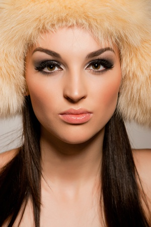 Brunette girl in hat, portrait close up shot photo
