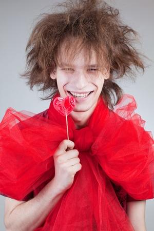 Crazy lachende jongen met lolly Stockfoto