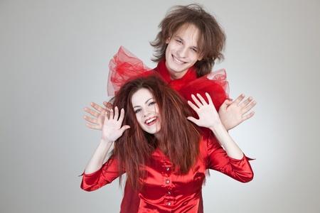 Happy pair, horizontal studio shot photo