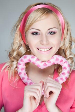 Happy glamorous girl, holding heart photo