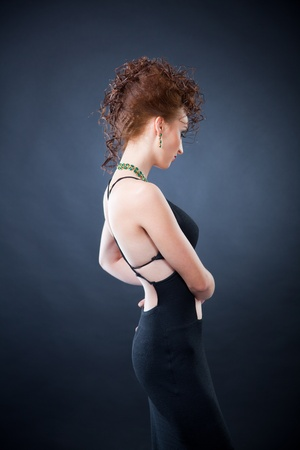 woman buttocks: Sad elegant young woman, looking down Stock Photo