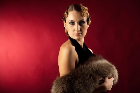 Portrait of woman holding natural fur photo