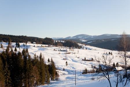 Village in snow, outdoor winter shot photo