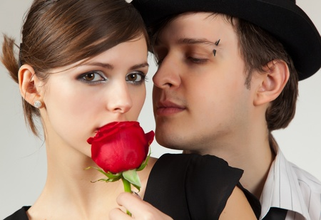 piercing: Young pair and rose, portrait studio shot