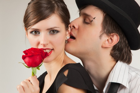 love kiss: Romantic portrait of young pair, studio isolated shot