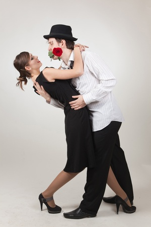 Elegant pair dancing, studio isolated shot Stock Photo