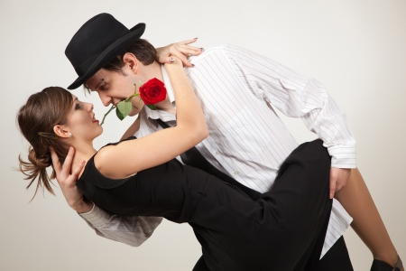 Dance with passion, two people and rose