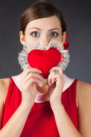 Shocked girl holding heart, close up studio isolated shot Stock Photo - 8974184