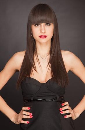 Brunette atractive girl with fringe, portrait close up studio isolated shot