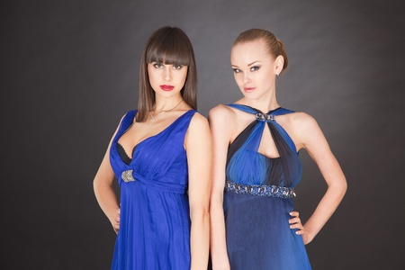 saxy: Two young girls in elegant dresses, studio isolated shot