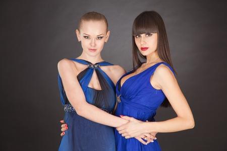saxy: Girls in elegant blue dresses, studio isolated shot