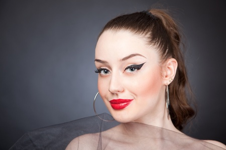 Smiling girl with red lips, portrait shot photo