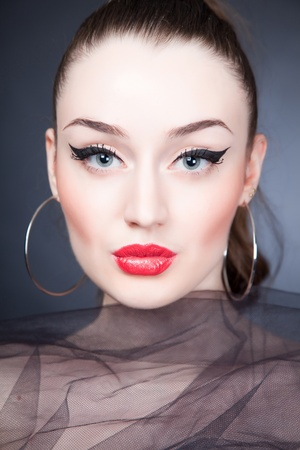 earring: Beautiful portrait of girl with stylish make up, close up shot