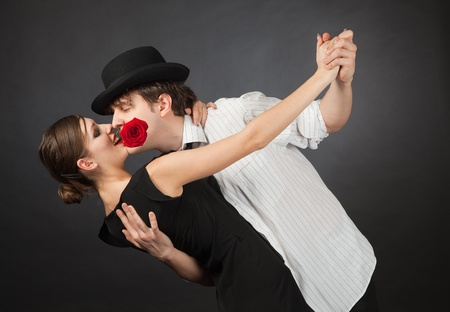 tango dance: Professional dancers, girl holding red rose in mouth Stock Photo