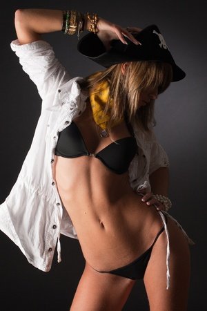 Sexy pirate, studio slose up vertical isolated shot Stock Photo