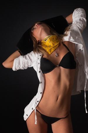 Erotic posing girl in pirate hat, close up studio shot