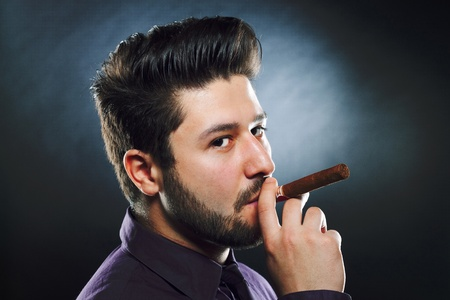 Smoking cigar man, close up portrait photo