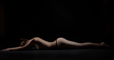 Body lines, studio isolated shot of nude girl laying Stock Photo - 9888733