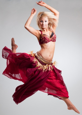 Posing in motion bellydancer, studio isolated shot photo