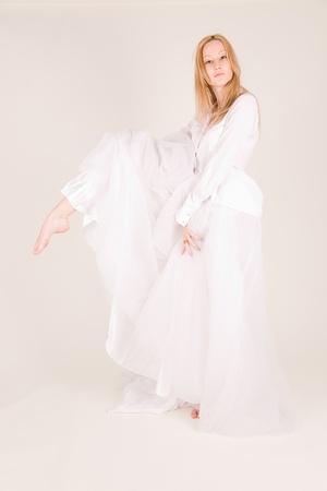 Professional ballet dancer, studio isolated shot photo