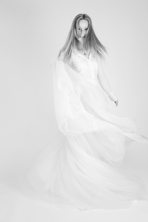 Monochrome shot of dancing girl with long skirt, studio shot photo