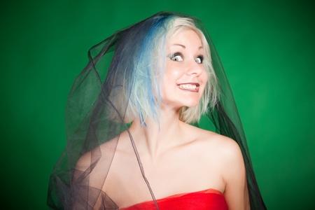 Crazy grimace, close up portrait shot over green background Stock Photo - 9888779