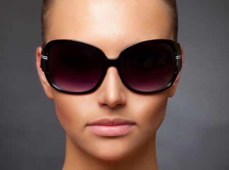 Close up stylish image of caucasian girl wearing sunglasses photo