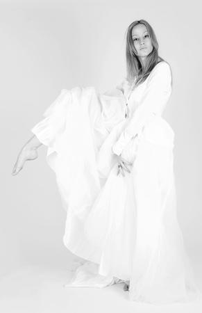 Monochrome shot of ballet dancer, vertical studio isolated image photo