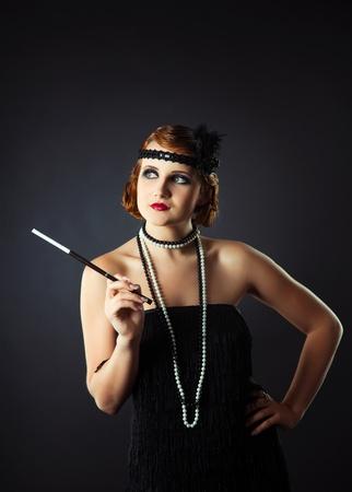 Retro-styled portrait of lady holding mouthpiece photo