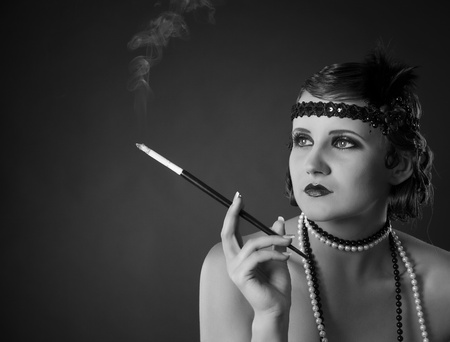 Monochrome retro-styled portrait of lady holding mouthpiece photo