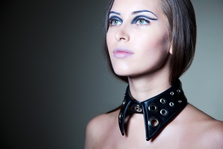 clinch: Girl with stylish make up and black collar