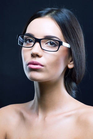Close up portrait of a girl with stylish optical glasses photo