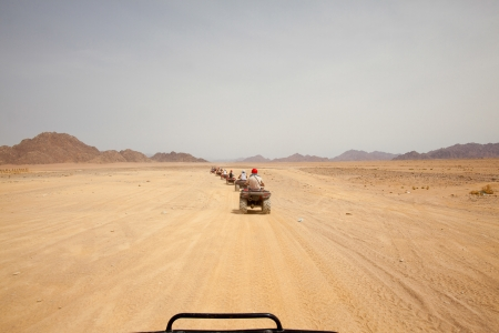sinai: Quad bike safari in desert, outdoor horizontal shoot Stock Photo